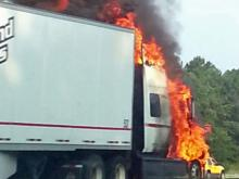 Authorities briefly closed all lanes of Interstate 40 West near N.C. Highway 147 Wednesday morning after a tractor-trailer caught fire on the shoulder. (Photo by Srini Iyengar)