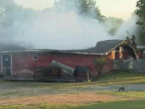 Firefighters from several departments were battling a fire early Friday at Pitchers Bar in Benson, Johnston County officials said.