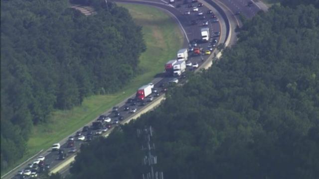 Traffic backs up on Interstate 40 West in Orange County on July 26.