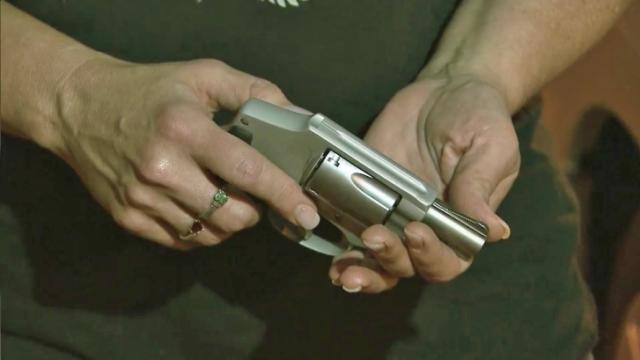 Kelli Hamilton showed the gun she has a concealed-carry permit for