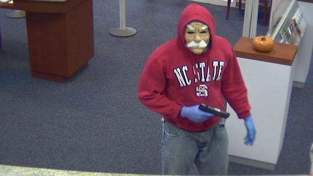 Authorities released this security video image of a robbery at the PNC Bank on Governor's Drive in Chapel Hill.