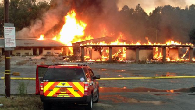 Firefighters were letting an abandoned hotel on Fayetteville's Eastern Boulevard burn out Monday afternoon.