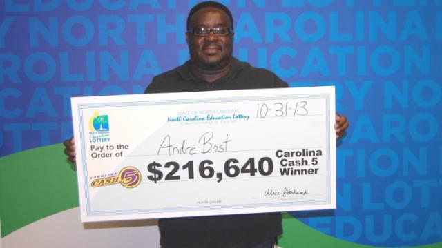 Andre Bost claimed his winning lottery ticket after walking around with it in his wallet for two weeks, unaware of his fortune.