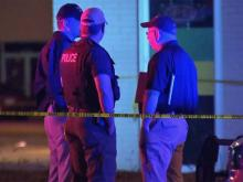 Fayetteville police were searching for clues Friday to determine the cause of a shooting outside a nightclub that left two dead and two others injured.
