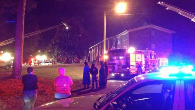 Firefighters were battling a blaze Monday, Nov. 25, 2103, at a Fayetteville apartment building that displaced several tenants.