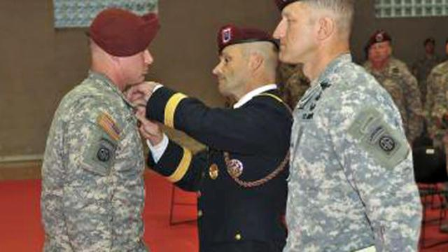 Spc. Michael D. Parmelee is pinned with the Soldier's Medal during a ceremony Nov. 26, 2013, at Fort Bragg. Photo by Staff Sgt. Jason Hull.
