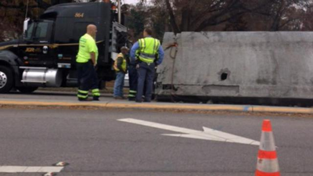 A truck carrying concrete barriers spilled its load on Wade Avenue in Raleigh on Wednesday, Dec. 4, 2013.