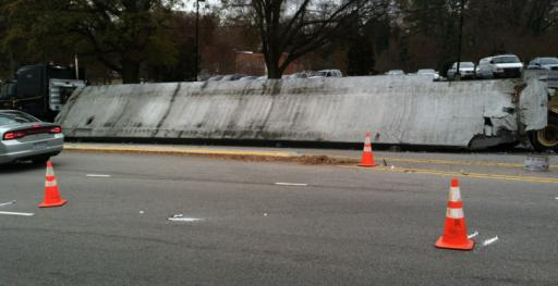 A truck carrying concrete barriers shifted and spilled its load on Wade Avenue in Raleigh on Wednesday, Dec. 4, 2013.