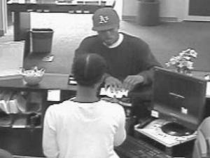 Fayetteville police were seeking the public's help Thursday to locate a man wanted in connection with a Wednesday robbery at a bank west of downtown.