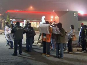 Workers protest for better wages outside of a Burger King on Capital Boulevard on Thursday, Dec. 5, 2013.