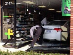 A car drove through the front of a Batteris Plus store on Ten-Ten Road in Apex on Dec. 6, 2013.