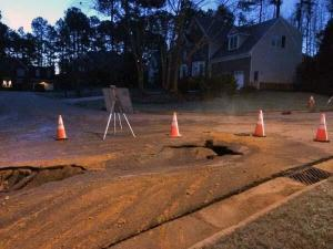 A water main ruptured early Wednesday, Dec. 11, 2013, in a neighborhood off of Ten-Ten Road in Cary, town officials said. (Photo courtesy Shannondoah Deaver)