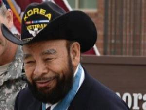 Medal of Honor recipient Ret. Cpl. Rodolfo (Rudy) Hernandez, pictured as the grand marshal for the 2013 Fayetteville Veteran's Day parade on Nov. 9, 2013, died Dec. 21, 2013, at the age of 82.
