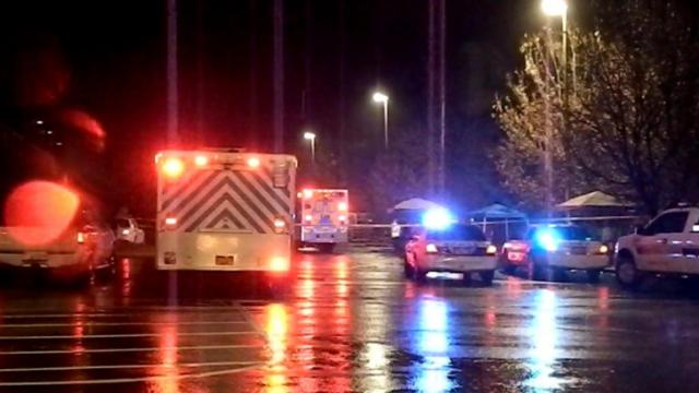 Southern Pines police and emergency personnel respond Dec. 22, 2013, to a fatal shooting in the parking lot of Lowe's Home Improvement at 10845 U.S. Highway 15-501. (Billy Marts/Contributor)