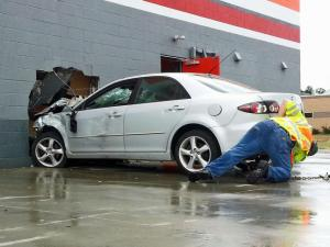A man was injured and sent to the hospital Monday morning after his car crashed into the side of an AutoZone store in Fayetteville. (Greg Clark/WRAL)