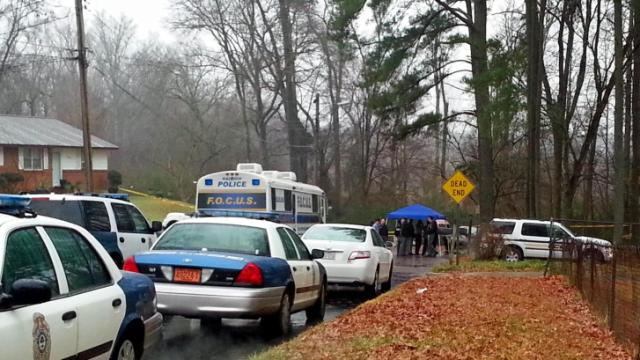 Raleigh police investigate the discovery of a body at the end of Belmont Drive on Jan. 2, 2014. (Adam Owens/WRAL)