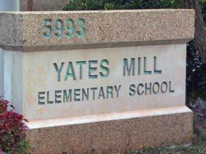 A Wake County elementary school teacher assistant is accused of cyber-bullying her ex-boyfriend and his family.