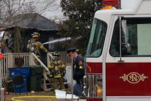 An adult and two children were taken to the hospital after a mobile home fire at 3000 Stonybrook Drive Sunday morning. (WRAL/Jamie Munden)