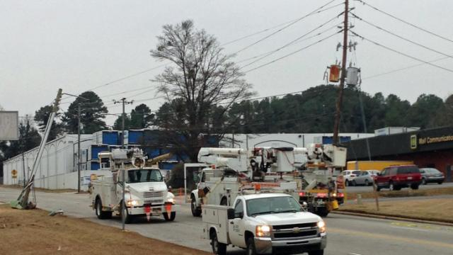 A damaged utility pole caused traffic delays along Atlantic Avenue in Raleigh during the morning commute on Feb. 11, 2014.