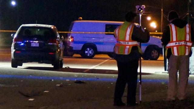 A man was killed and a woman seriously injured after a SUV hit the pair as they crossed Cedar Creek Road near Bureau Drive Thursday evening. (WRAL/Adam Owens)