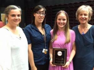 Miranda Staubel (holding the plaque) poses with Lucas Assistant Principal Sarah Sanchez, Lucas AIG Facilitator Amber Longee and her mother, Marjorie George.