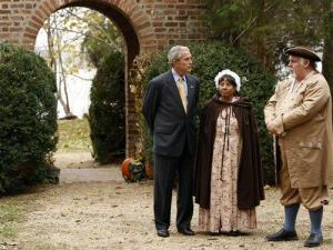 President Bush talks with Jim Curtis, left, and Mattie Jones, dressed in period costumes, at the Thanksgiving Shrine at Berkeley Plantation in Charles City, Monday, Nov. 19, 2007, prior to the holiday Thursday. (AP Photo/Gerald Herbert)