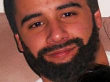 An FBI photograph released April 4, 2008, of what Cesar Laurean might look like with darker skin and a bearded face. Wanted in the death of Marine Lance Cpl. Maria Lauterbach, Laurean is believed to be in Mexico.