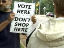Both parties protest mall electioneering rules