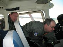 Major Dion Vivento (left) and Col. Larry Ragland (right) inspect CAP aircraft cockpit. (Photo courtesy of Civil Air Patrol)