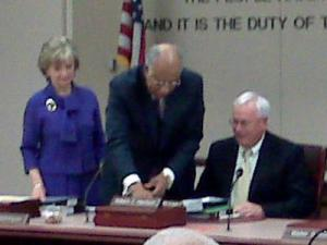 Former state Board of Education Chairman Howard Lee takes off his nameplate so new chairman, Bill Harrison, can add his. June Atkinson, the elected state superintendent of public instruction, stands to the left.
