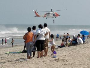 A Coast Guard helicopter lowers a rescuer into the water in the search for Master Emanuel Carter, 10, of Sanford, who disappeared in the surf off Carolina beach Saturday, Aug. 8, 2009. (Photo courtesy of the New Hanover County Sheriff's Office)