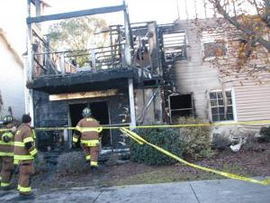 Firefighters investigate a fire early Saturday at the Cypress Pointe Apartment Homes in Wilmington. (Photo courtesy of Wilmington Star News)
