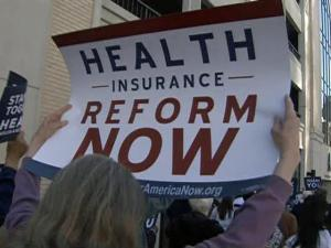 Health care reform supporters marched and rallied outside the downtown Raleigh office of Democratic 2nd District  congressman Rep. Bob Etheridge two days before the U.S. House votes on a $940 billion health care reform bill.