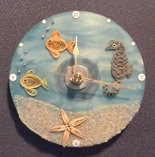 Clock, crafted with quilling, made from a recycled CD. From Marie Dowdee of Efland.
