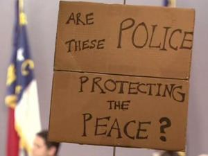 Some people affiliated with Occupy Chapel Hill protested the city's response to an earlier occupation event in a vacant downtown building at the Chapel Hill Town Council meeting Monday evening.