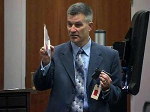 During closing arguments on Dec. 19, 2011, Orange County District Attorney Jim Woodall holds the gun he says Laurence Lovette Jr. used to shoot Eve Carson four times on the morning of March 5, 2008.