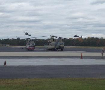 Two Blackhawk helicopers wait to depart for an aid mission to hurricane-damaged New Jersey from the North Carolina National Guard base in Morrisville.
