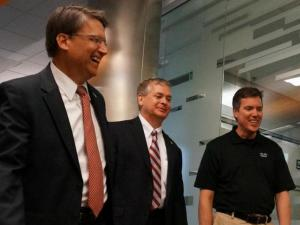 Cisco engineer Paul Giralt takes Gov. Pat McCrory and State Chief Information Officer Chris Estes on a tour of the firm's Research Triangle Park office ahead of a job announcement on June 6, 2014. (Photo by Tyler Dukes)