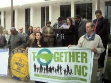 Groups rally against drastic budget cuts