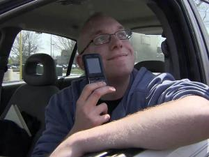 Daniel Wolfe said he keeps his cell phone by his side while driving and opposes a bill that would require drivers to use hands-free devices while on the phone.