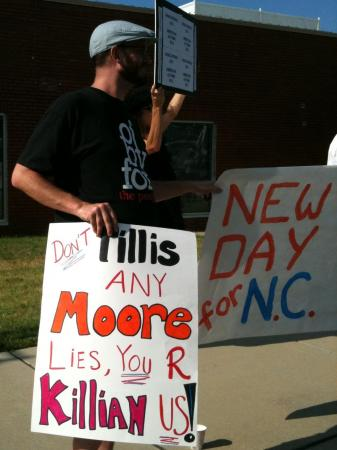 Democracy NC's Adam Sotak protests a House GOP fundraiser, June 29, 2011
