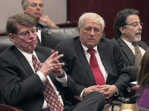 "Trawick ""Buzzy"" Stubbs, center is flanked by attorneys David Long, left, and David Rudolf during a May 11, 2012, hearing on charges that Stubbs broke campaign finance laws by providing Perdue flights aboard a private plane."