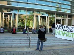 Several people opposed to natural gas drilling in North Carolina chained themselves to the entrance of state environmental offices in downtown Raleigh on Oct. 22, 2012.