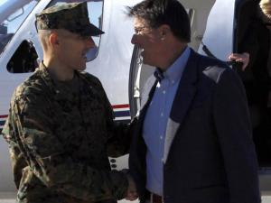 Marine Brig. Gen. Thomas Gorry, commanding general of Camp Lejeune, shakes hands with Gov.-elect Pat McCrory as he lands at Marine Corps Air Station New River on Dec. 14, 2012, during a tour of North Carolina military installations with Gov. Beverly Perdue. (Photo courtesy of Marine Corps)