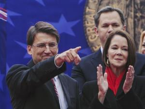 Gov. Pat McCrory spots a familar face in the crowd at the commencement of the 2013 Inaugural Ceremony.