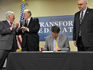 Gov. Pat McCrory signs his first bill into law on Feb. 18, 2013, at Randolph Community College in Asheboro. Senate Bill 14 places more emphasis on vocational education in North Carolina high schools.