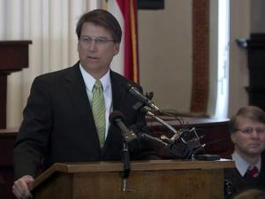 Gov. Pat McCrory names the commanders of the State Highway Patrol, the Division of Alcohol Law Enforcement and the State Capitol Police during a March 28, 2013, ceremony.