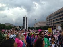 Demonstrators, many wearing pink, rallied outside the North Carolina Legislative Building Monday evening in the first 'Moral Monday' protest since the state Senate approved an unexpected bill last week increasing restrictions on abortion providers.