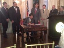 Gov. Pat McCrory signs the 2013 tax bill into law
