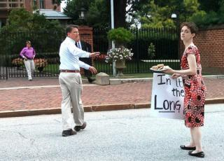 Gov. McCrory walks away after handing protestor Jamie Sohn the plate of cookies. (Courtesy Planned Parenthood/Irene Godinez)
